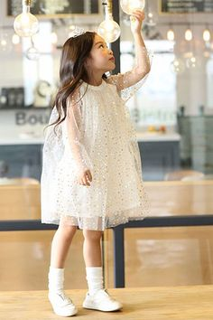 Soft tulle dress with gold foiled stars printed all overLined for comfort  Perfect magical little dress.