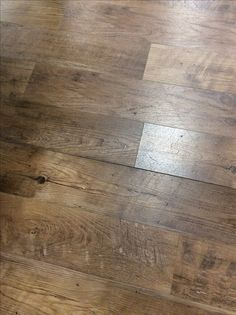 Don't you just love this beautiful floor? It is so full of character and texture! But wait here is the surprise, it isn't a solid wood floor, nor and engineered wood floor, but in fact it is a Luxury Vinyl Plank (LVP) made by Mannington in color Dockside Pier! This LVP called Endura comes either in a glue down or click and is economical, durable, scratch resistant and you will want it in every room of your home!