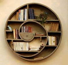 Spiral bookshelf-This is really neat. I love Nautilus shells and this is so reminiscent of them I want one for my house. Must build this for our home.