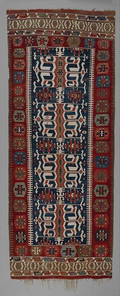 Carpet  Date:     ca. 1800 Geography:     Turkey Culture:     Islamic Medium:     Wool, cotton, and metallic silver thread Dimensions:     64 3/16 x 163 3/8 in. (163 x 415 cm) Classification:     Textiles