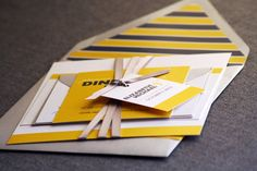 Yellow, grey and white wedding invite with striped envelope liner