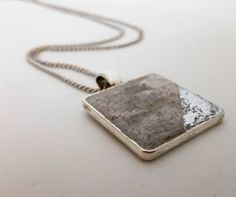 This is the silver plated concrete pendant with marble effect and silver flakes.