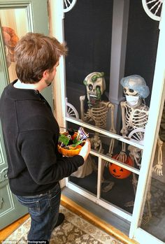 couple photograph their festive skeletons doing everyday activities halloween humordiy halloweenhalloween decorationsphotos - Walgreens Halloween Decorations