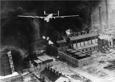 Consolidated B-24D-55-CO Liberator 42-40402, The Sandman, clears the triple stacks at Astra Romana, Ploesti, Romania, 1 August 1943. (U.S. Air Force)