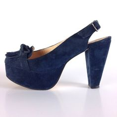 """Blue Suede Chunky Pinup Slingbacks w/ Kiltie Super cute 40s-inspired blue suede pinup-style platforms with moccasin kiltie & bow detailing. Features adjustable slingback strap w/ silver buckle, & unique chunky tapered heel. Great condition; only worn once but have some minor scuffs & dust from shelf life, & a small area on footbed where sticker was removed (see 3rd frame of last pic). Purchased at Blue & Cream. Heel:4.25"""". Platform:1.5"""".  Charlotte Ronson Shoes Platforms"""