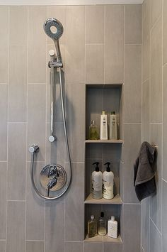 Vertical shower niche Like that the tile in the niche is the same as the shower tile. Upstairs Bathrooms, Laundry In Bathroom, Bathroom Renos, Bathroom Renovations, Small Bathroom, Master Bathroom, Bathroom Storage, Bathroom Recessed Shelves, Shower Shelves