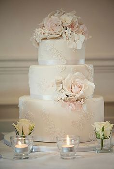 3 tier wedding cake with slight lace applicades