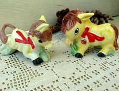 Check out this item in my Etsy shop https://www.etsy.com/listing/88505990/vintage-donkey-salt-pepper-shaker-set