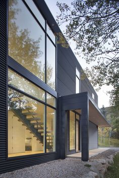 black corrugated metal house exterior, contemporary architecture, by architects Rowland & Broughton