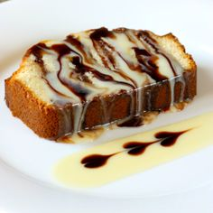 Condensed Milk Pound Cake drizzled with more condensed milk and chocolate syrup