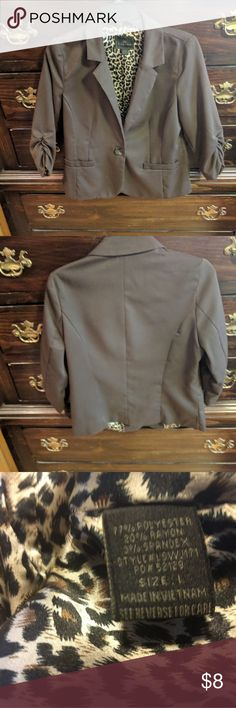 Timing stylish business dark brown blazer! This blazer is a dark brown hue. It has two decorative/ fake pockets in front to add style as well as 3/4 length    ruched sleeves. It has a shiny leopard print lining inside. It's in great condition! It's been worn maybe once. It's great for work! Timing Jackets & Coats Blazers