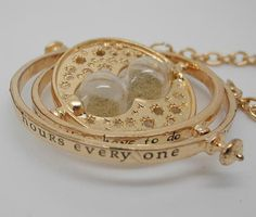 Hey, I found this really awesome Etsy listing at https://www.etsy.com/listing/161962646/harry-potter-time-turner-replica-gold