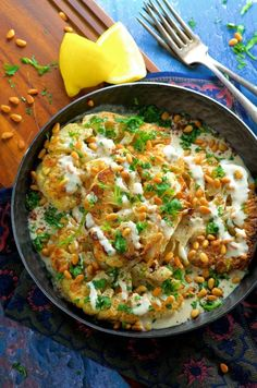 Roasted Cauliflower Steaks with Tahini and Pine Nuts. A delicious vegetable centered entree that even meat lovers will enjoy! Pine Nut Recipes, Vegan Recipes, Vegan Meals, Yummy Recipes, Alkaline Recipes, Savoury Recipes, Simple Recipes, Vegan Foods, Healthy Foods
