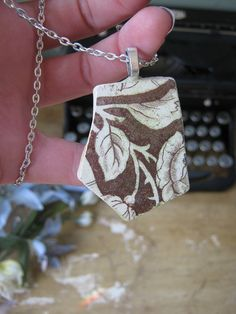 European Victorian Sea Pottery Pendant https://www.etsy.com/listing/93072384/brown-rose-sea-pottery-pendant-designs?ref=v1_other_1