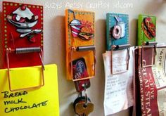 Cute DIY; painted mouse traps for hanging mail, keys, pictures.