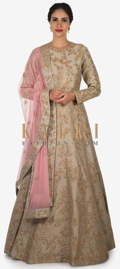 Buy Online from the link below. We ship worldwide (Free Shipping over US$100)  Click Anywhere to Tag  .Dull grey anarkali gown with pink dupatta crafted with heavy zari resham embroidery work only on Kalki