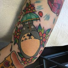 Totoro tattoo by Alex Rowntree. #flowers #traditional #totoro #AlexRowntree #anime