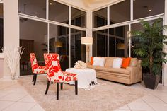 Inspired by the Shadings of a Sunset - tropical - family room - miami - by Inspired Interiors by Wendi, IIDA