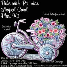 """Bike with Petunias Shaped Card Mini Kit on Craftsuprint designed by Sandie Burchell - A lovely Bike Shaped Card adorned with Basket of Petunias. The Mini Kit has 2 pages which includes an 8"""" x5.5"""" approx Card Front with Decoupage, Card Back, Accordion Fold Base, Optional Butterflies, Writing Panel and choice of Sentiment Panels. Sentiments included are: Happy Birthday, Especially For You!, Best Wishes, Special Sister, Special Daughter, Special Friend, Special Wife, Special Mother, Special…"""