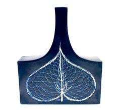 A single large variegated leaf decorates this modernist vase designed under the direction of Kaj Franck for Arabia, Finland, 1960s. The glaz...