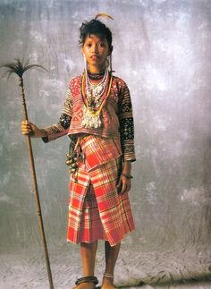 """Kalagan-Tagakaolo: Malalag, Davao del Sur. 'Sinaunang Habi' ni Marian Pastor-Roces  """"Brainie's mother is Tagakaolo, and her father, Tiruray, but she grew up in her mother's culture. Her mother, who guardedly supervised the pictorial, assembled the outfit: suwat, comb; lupi, earrings; balyog, necklace; lampad, """"necklace/protector'; the bong panayan, embroidered blouse; the bracelet linte; tungkaling, bells, keys and tikos vine; patadyong of  cotton plaid; and babat, anklets. Philippines Fashion, Philippines Culture, Marian Rivera, New Fashion, Fashion Show, Vintage Fashion, Modern Filipiniana Gown, Body Painting Festival, Filipino Culture"""