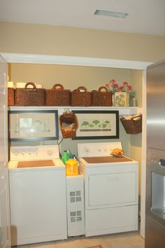 laundry closet idea...LOVE the baskets up top for concealed storage.   Wonder if I could fit an organizer between my washer and dryer like this???