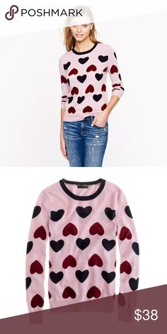 J. Crew Heartbreaker Sweater Cute sweater perfect for Valentine's Day. Hearts are an intarsia knit (knitted into sweater not on top). Viscose/wool/nylon/angora in a 7-gauge knit. Long sleeves. Rib trim at neck, cuffs and hem. Hits at hips. Pre-owned in good conditions - no holes or stains. ❌NO TRADES❌NO PAYPAL❌ J. Crew Sweaters Crew & Scoop Necks