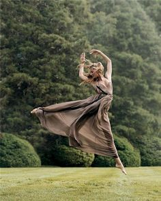 long flowy dress in a meadow, simple but comes across strong