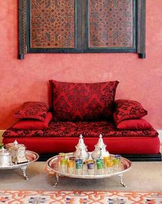 Chic Moroccan decor with traditional tea service-- cute for a little reading area