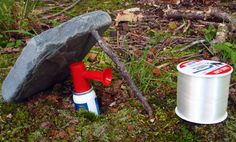 Easy way to build a perimeter bear alarm for your camp with a boat horn, some monofilament, a rock and a stick.