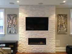 Artwork by Maya Eventov from Crescent Hill Gallery in Mississauga, ON Modern Stone Fireplace, Stone Fireplace Designs, Contemporary Fireplace Designs, Fireplace Tv Wall, Fireplace Remodel, Living Room With Fireplace, Fireplace Facing, Fireplace Ideas, Stone Accent Walls