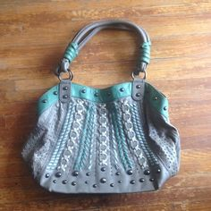 Large Grey/Turquoise Handbag Large bag with zipper compartments inside and a center divider. Outside has one pocket. Has a bit of wear but nothing major, a few tiny tiny nicks on the back. Bags