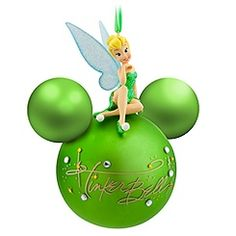 Tink makes a name for herself on this Figurine On Ball Tinker Bell Ornament. The fairy's golden signature is surrounded by rhinestones while Tinker Bell sparkles in her glittering costume as she sits Tinkerbell Ornament, Tinkerbell And Friends, Tinkerbell Disney, Tinkerbell Fairies, Disney Fairies, Tinkerbell Party, Images Disney, Art Disney, Disney Love