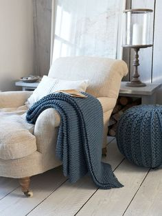 Vintage blue throw and knitted pouffe