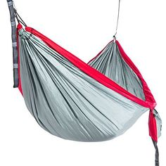Camping Hammock - Parachute Nylon Deluxe Single With Ripstop - - Daisy Chain Straps & Compression Sack ($30 Value) - Beach, Travel, or Backyard Fun!  PERFECT SIZE HAMMOCK FOR BEST SLEEP EVER, PROVIDES BED LIKE COMFORT: Lie comfortably flat while not DROWNING IN FABRIC as with a double. Big enough for 2 to sit comfortably in.  NO WORRIES, NO RIPPING, VERY STABLE: 210T parachute nylon hammock WITH RIPSTOP supports up to 600lbs. Deluxe single hammock deters flipping compared to singles yet is…