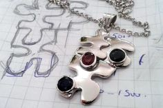 hand made puzzle 14k white gold necklace. Ruby and sapphire stones