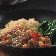 Slow-cooker Eggplant & Chickpea Stew -- a perfect Phase 3 supper, served over quinoa with sauteed spinach on the side. This recipe would serve 6 as written.