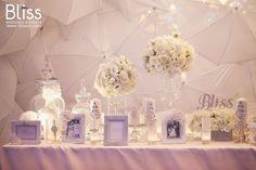Paradise Wedding - Bliss Weddings & Events. The dazzling ceiling, warm candles and Bliss's luxurious crystal helped make the fairy tale more beautiful. #blissweddings&events  #blissevents #weddingfairdecoration #whiteweddingdecor #whiteweddingideas #appleweddingideas #luxuryweddingdecor