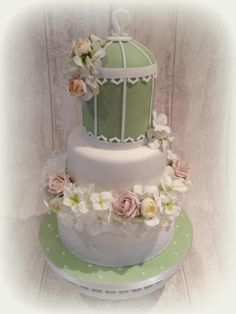 Birdcage wedding cake and cupcakes