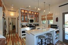 Love the glass front cabinets, makes the kitchen look bigger and brighter!