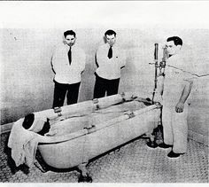 Mental patient receiving hydrotherapy treatment, under the watch of hospital staff & orderly