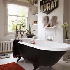 KCK bathroom remodeling ideas: Fantasy Bathroom Series: CLAWFOOT BATH TUB | Adding Drama with Black: Whether glossy or matte, painting your clawfoot tub Black will add drama to your bathroom, and is especially beautiful if you have a lot of natural light available.