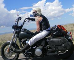 S. Masyn Moyer (from Colorado), relaxin' on her Harley. Man, I love women who ride.
