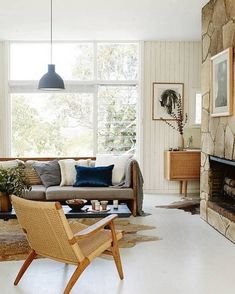 In love with the modern mountain style so naturally this living room featured in Domino has us . Swooning over the Rove Concept woven lounge chair too! We found it for less than $700!   http://ift.tt/2z0OuPe #CopyCatChic