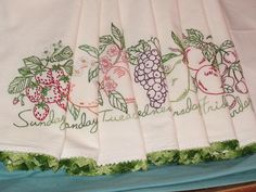 Set of 7 hand embroidered flour sack towels with crochet trim.