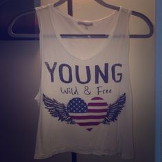 Young wild & free crop tank NWOT. Literally removed tag and never wore. White super soft fabric.white crop top. Charlotte Russe Tops