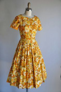 """sunflower field's hues and boasting a super cute Peter Pan collar, this wonderful 1950s yellow and orange floral print cotton sundress is the sort of garment that cannot help but lift your spirits every time you put it on it"""