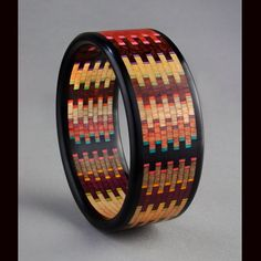 "Martha Collins, 2011 Size   H: 2.75 in  W: 2.75 in  D: 0.8 in    Weight: 0.8 oz Available for Purchase This striking bracelet has 400 pieces with Ebony edges. The design is a ""weaver"" offset. I love the color in this bracelet, it's a ""hole in one"" !! Bracelets come in sizes from 57 mm to 70 mm diameter."