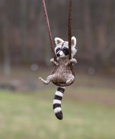 Tiny Raccoon Necklace  needle felted by motleymutton on Etsy, $40.00