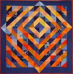 SUNRISE by Madeleine Appell on the SAQA site. Half-square triangles, love the color and how the lines break the border!